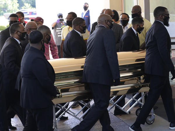 The casket of George Floyd arrives Monday for a public memorial at The Fountain of Praise church in Houston.