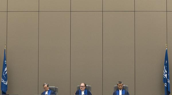 A trio of judges oversees a trial in 2017 at the International Criminal Court in The Hague, Netherlands.