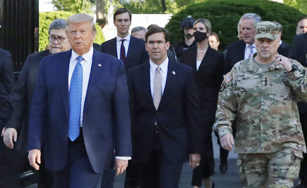 """Gen. Mark Milley (right) appears with President Trump as he departs the White House en route to St. John's Church on June 1. Milley now says his presence """"created a perception of the military involved in domestic politics."""""""
