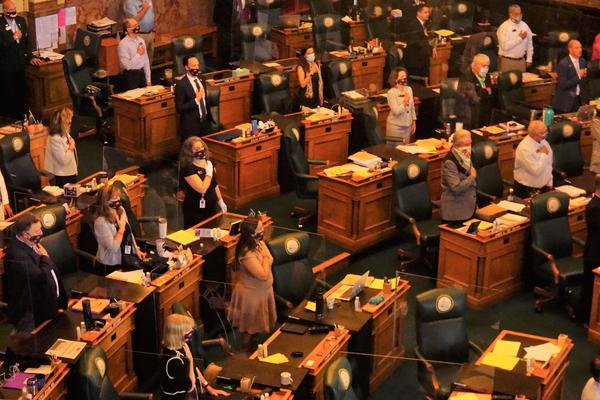 State lawmakers went into an emergency recess on March 14 because of the coronavirus pandemic. When they returned, the wore masks and sat between plexiglass barriers.