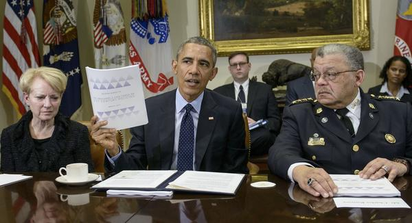Laurie Robinson, left, professor of criminology at George Mason University, and Charles Ramsey, right, Philadelphia police commissioner, listen while President Obama discusses law enforcement recommendations from his Task Force on 21st Century Policing in March 2015.