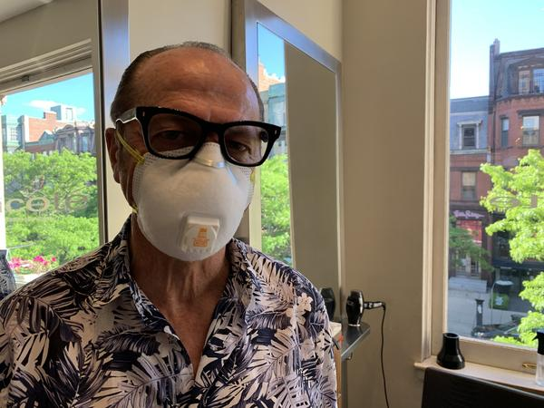"""The Boston salon where Vincent Cox works has reopened, and the 65-year-old is back at work. """"It's been one of the hardest things I've ever done in my life,"""" he says."""