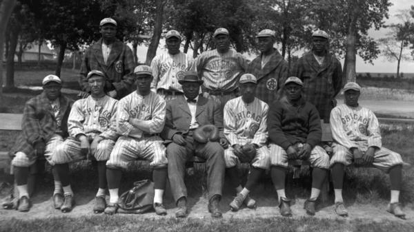 """Members of the Chicago American Giants pose for a team portrait in 1914 in Chicago. (L to R) (Front row) Billy """"Little Corporal"""" Francis, Richard """"Dick"""" Whitworth, Joseph Preston """"Pete"""" Hill, Andrew """"Rube"""" Foster, Bruce Petway, James """"Pete"""" Booker, unidentified. (Back row) Bill Gatewood, Jesse Barber (aka Barbour), Leroy Grant, John Henry """"Pop"""" Lloyd, Robert """"Jude"""" Gans."""