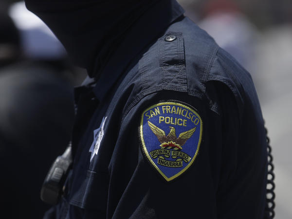 A San Francisco Police Department patch is shown on an officer's uniform. A new Pew Research Center survey shows changing opinions about law enforcement.