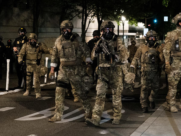 Federal officers prepare to disperse the crowd of protesters outside the Multnomah County Justice Center on July 17 in Portland. The use of federal agents has only made a bad situation worse, state and local officials told NPR.