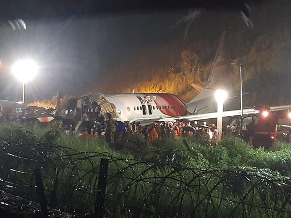 The wreckage of an Air India Express flight after it skidded off a runway Friday night at Kozhikode International Airport in the Indian state of Kerala.