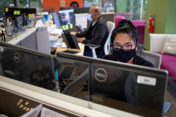 Harris County Public Health contact tracers are seen at work as they try to help stop the spread of the coronavirus outbreak in Houston, Texas, on July 22.