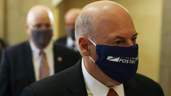 Postmaster General Louis DeJoy, pictured at the U.S. Capitol on Aug. 5, denies any slowdowns at the U.S. Postal Service are part of any attempt to reduce voting by mail this year.