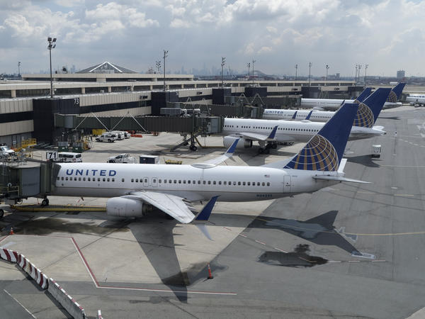 United Airlines planes are parked at gates last month at Newark Liberty International Airport in New Jersey. The airline announced it is eliminating many change fees, and Delta Air Lines and American Airlines quickly followed.