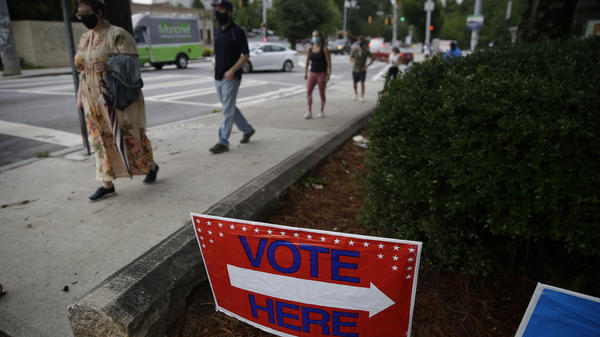 People wait in line to vote in Georgia's primary election on June 9 at Park Tavern in Atlanta.
