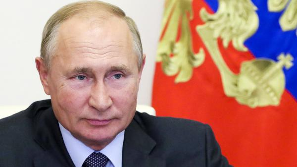 Russian President Vladimir Putin attends a meeting on economic issues via video conference Thursday at his Novo-Ogaryovo residence outside Moscow.