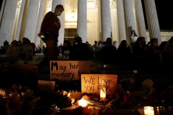 Mourners gather during a vigil for Supreme Court Justice Ruth Bader Ginsburg outside of the Supreme Court in Washington, D.C., on Friday.