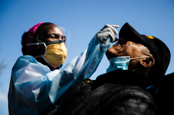 Dr. Ala Stanford administers a COVID-19 test in Philadelphia. Stanford and other doctors formed the Black Doctors COVID-19 Consortium to help address the pandemic's heath disparities.