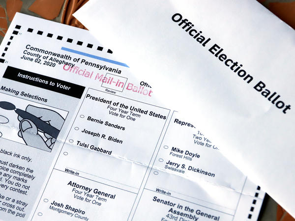 This May 26 photo shows an official Democratic primary mail-in ballot and secrecy envelope for the Pennsylvania primary in Pittsburgh.