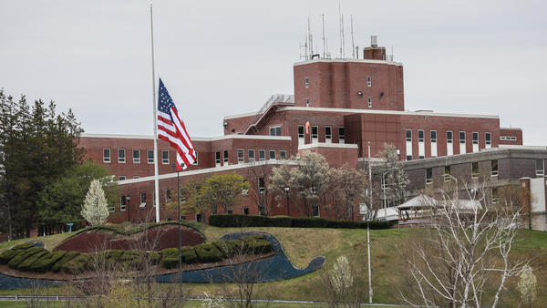 An American flag flew at half-mast at the Holyoke Soldiers' Home in Massachusetts last spring, when dozens of veterans died at the facility. Two of its leaders are now facing criminal neglect charges over their handling of a COVID-19 outbreak.