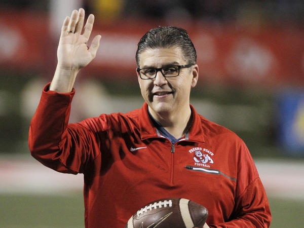 California State University, Fresno, President Joseph I. Castro waves to the crowd before an NCAA college football game against BYU in Fresno, Calif. on Nov. 4, 2017. Castro has been chosen as the chancellor of the California State University, becoming the first person of color to lead the nation's largest four-year public university system.
