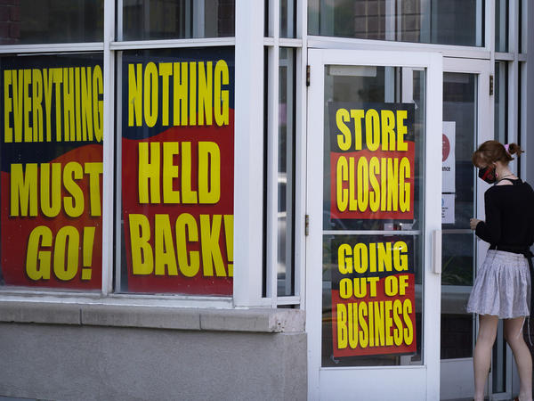 A store announces its looming closure in Salt Lake City on Aug. 30. An economic recovery is starting to show signs of losing momentum as businesses close and companies announce big layoffs.