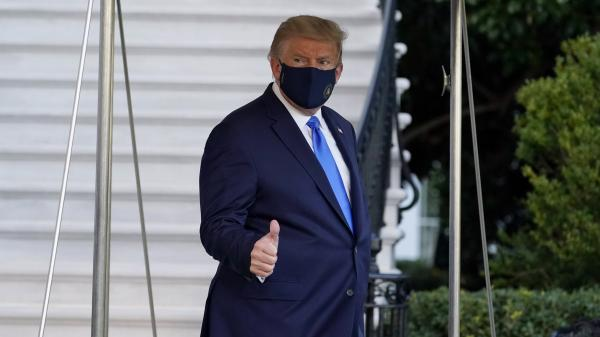 President Trump gives a thumbs-up as he leaves the White House to go to Walter Reed National Military Medical Center on Friday after he tested positive for the coronavirus.