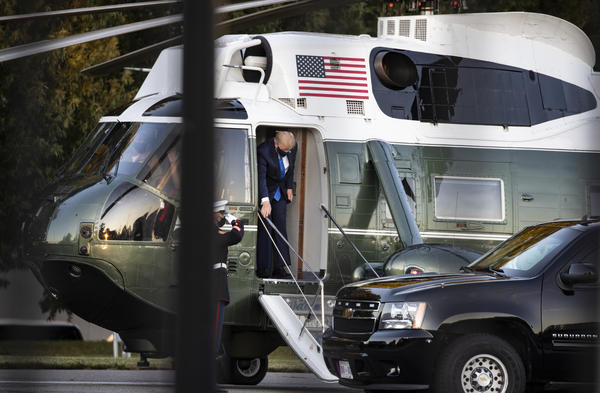 President Trump exits Marine One at Walter Reed National Military Medical Center on Friday in Bethesda, Md. He is staying at the hospital while receiving treatment for the coronavirus.