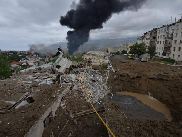 Smoke rises in the aftermath of recent shelling during the ongoing fighting between Armenia and Azerbaijan. This photo, provided by the Armenian government, shows the aftermath of recent shelling in the city of Stepanakert.