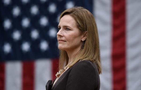 Judge Amy Coney Barrett, here at the White House on Sept. 26, is President Trump's Supreme Court nominee — and she has gun control groups worried.