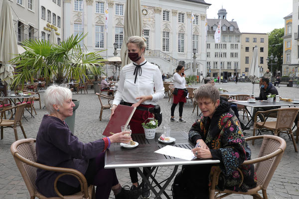 Outdoor dining in Bonn, Germany. Indoor dining is riskier than outdoor meals, experts say. Outdoor air can disrupt viral particles that have been expelled.