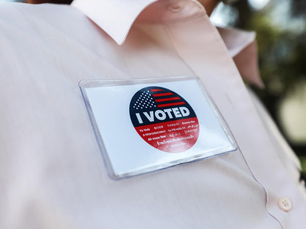 "A voter wears an ""I Voted"" badge after placing a ballot in a drop box in Los Angeles last week. Officials say members of the Republican Party have illegally placed unauthorized drop boxes in some locations."