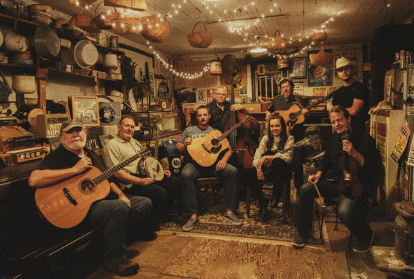 Before recording <em>Cuttin' Grass Vol. 1,</em> Sturgill Simpson (seated at center with guitar) assembled an all-star crew of bluegrass players to help him reimagine songs selected from across his own acclaimed — and genre-defying — albums.