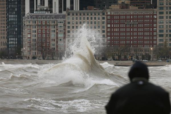 The remnants of Hurricane Sandy churn up Lake Michigan in Chicago in 2012. Flood risk in the city is increasing as climate change drives more extreme rain, and renters face greater financial peril than homeowners. More than half of Chicagoans are renters, according to 2019 census data.
