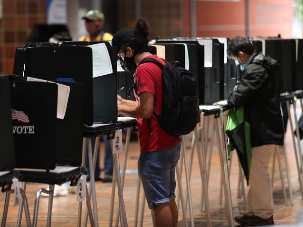 Voters fill out ballots this week at the Stephen P. Clark Government Center polling station in Miami.