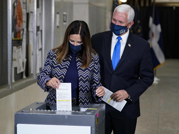 Vice President Pence and his wife, Karen, cast their ballots Friday during early voting in Indianapolis.