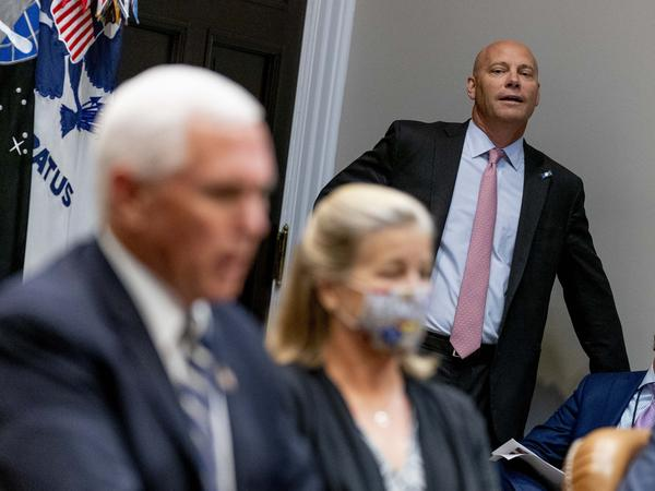 Marc Short, the chief of staff to Vice President Pence, listens to Pence speak during a White House event in September. Short tested positive for the coronavirus on Saturday.