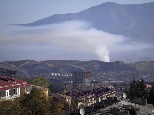 Smoke rises after shelling by Azerbaijan's artillery in Stepanakert, Nagorno-Karabakh, on Saturday.