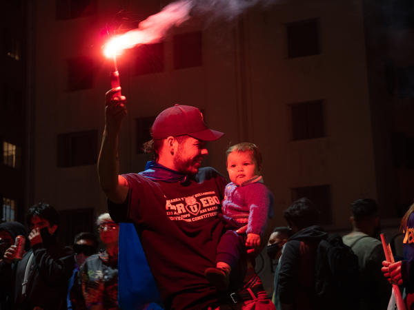 A family celebrates the approval of a new constitution in Santiago, Chile. After decades, the constitution from the country's years of dictatorship will finally be thrown out.