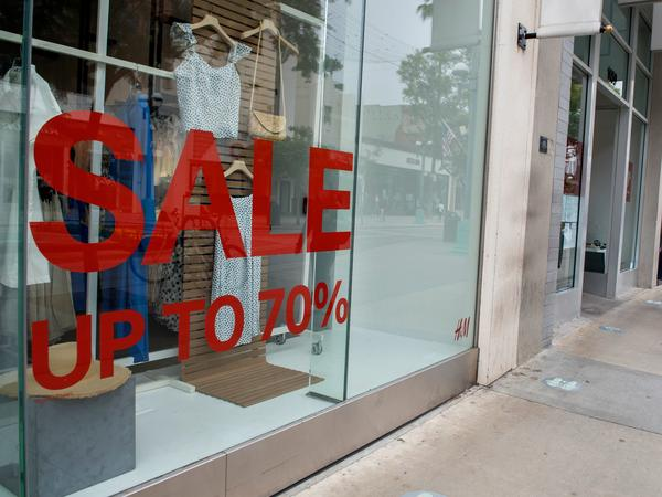 A store advertises discounts in Santa Monica, Calif., on July 28 amid the coronavirus pandemic. Economic growth data on Thursday are expected to show a record-setting figure for the third quarter, but that covers the more worrisome picture underneath the surface.