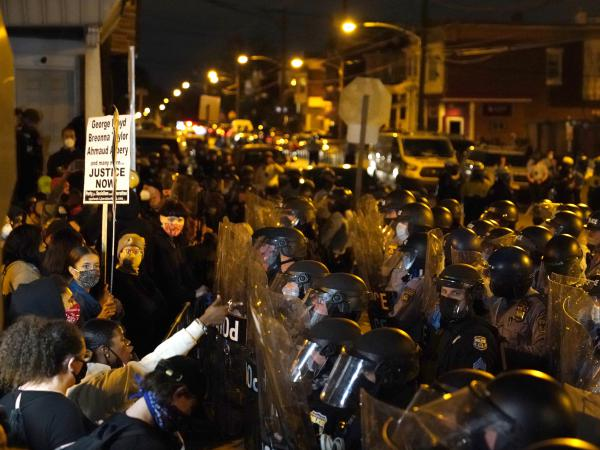 Protesters confront police during a march Tuesday in Philadelphia following this week's fatal police shooting of Walter Wallace Jr., a 27-year-old Black man.