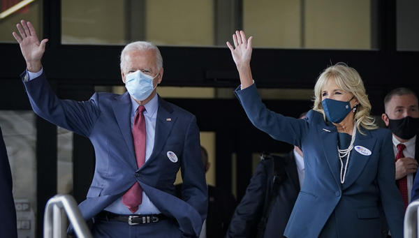 Democratic presidential nominee Joe Biden and his wife, Jill Biden, depart after casting their ballots Wednesday at the Carvel State Office Building in Wilmington, Del.