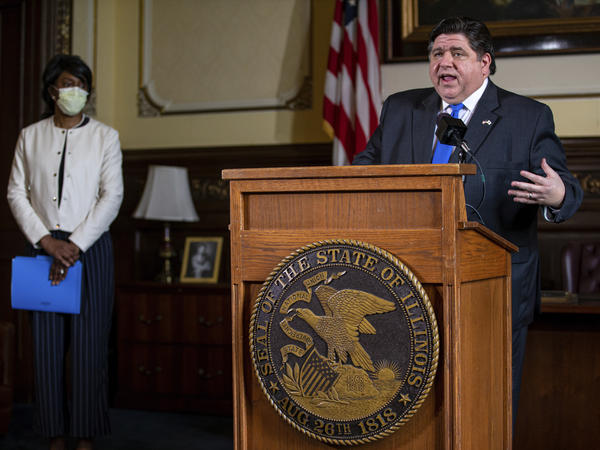 Illinois Gov. JB Pritzker answers questions from the media, along with Dr. Ngozi Ezike, director of the Illinois Department of Public Health, during his daily press briefing on the COVID-19 pandemic on May 22, in Springfield, Ill.