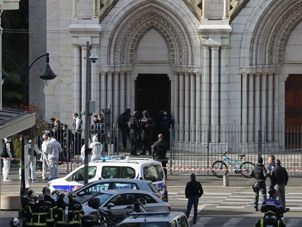 Members of a French elite tactical police unit search the Notre Dame Basilica in Nice after a knife attack that killed three people and injured several others on Thursday.