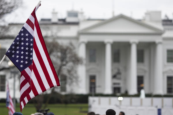 An anti-war protestor holds an upside-down American Flag during a demonstration against war in Iraq and Iran outside the White House on January 4, 2020 in Washington, DC. (Alex Edelman/Getty Images)