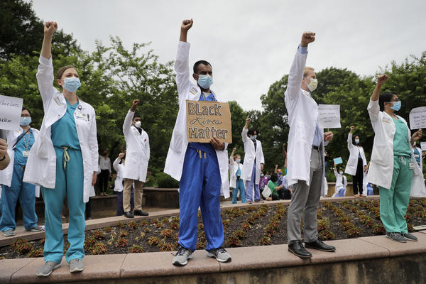 Health care professionals gather outside Barnes-Jewish Hospital in St. Louis in June to demonstrate in support of the Black Lives Matter movement.
