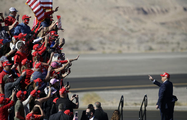 President Donald Trump gestures to supporters following a campaign rally on October 28, 2020 in Bullhead City, Arizona. With less than a week until Election Day, Trump and Democratic presidential nominee Joe Biden are campaigning across the country. (Isaac Brekken/Getty Images)