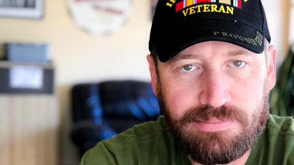 """I think in a lot of ways, we survived that deployment in Iraq by sharing humor with each other,"" said former Army Spc. Garett Reppenhagen, seen at home in Colorado Springs, Colo."