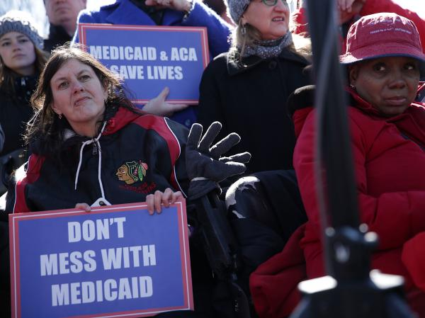 """Health care activists rallied in front of the U.S. Capitol on March 22, 2017, to protest Republican efforts that would have dismantled the Affordable Care Act and capped federal payments for Medicaid patients. The Republican congressional bills, part of the party's """"repeal and replace"""" push in 2017, were eventually defeated."""
