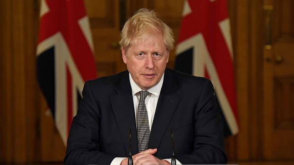 Prime Minister Boris Johnson speaks during a virtual press conference at 10 Downing Street in London Saturday to announce new lockdown restrictions in an effort to curb rising infections of the novel coronavirus.
