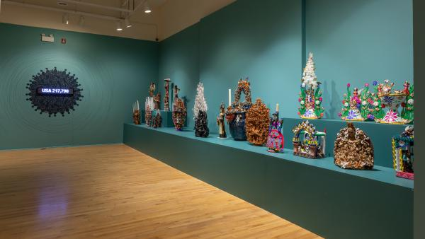 The National Museum of Mexican Art is paying tribute to those who have died of COVID-19 in its yearly exhibit for the Day of the Dead. A counter displays the number of people who have died.
