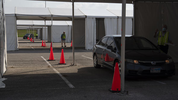 Voters drop off ballots last month at a drive-through polling place in Houston. Some 127,000 voters cast their ballots at drive-through locations in the Houston area.