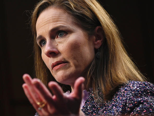 Amy Coney Barrett testifies during her confirmation hearings last month. The new justice heard her first arguments Monday as a member of the U.S. Supreme Court.
