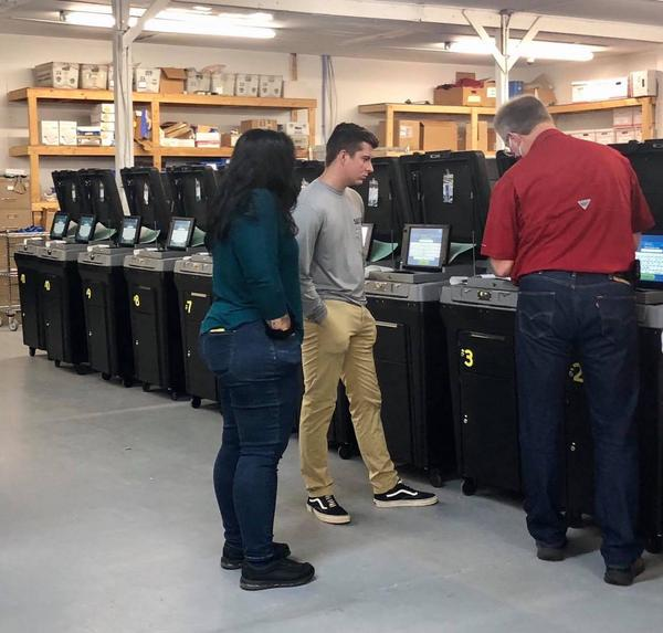 Okaloosa County Elections Supervisor Paul Lux shows poll workers how to use voting machines during a training session in early September.