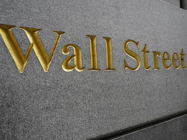 """""""Wall Street"""" is etched on a building across the street from the New York Stock Exchange in September. Stocks are rallying as voters head to the polls Tuesday."""